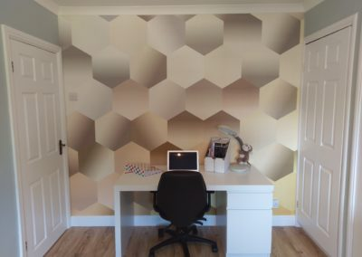 Hexagon feature wall image complemented by Little Greene celestial blue